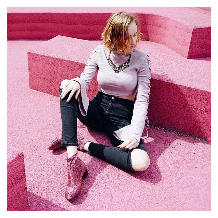 50c22865fc3af Break up a pair of sparkly hot pink boots and a cropped dusty rose sweater  with some classic black jeans. (Photo via @amandaskrabucha)